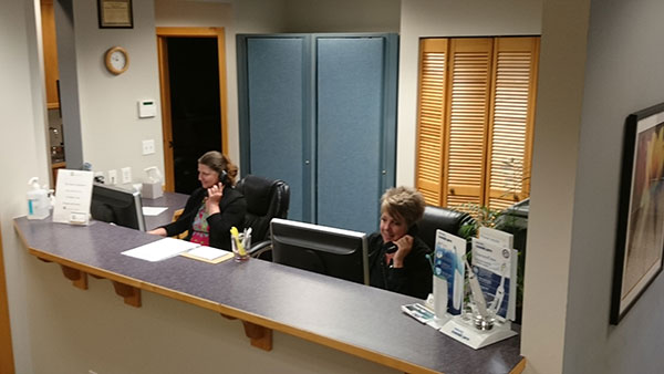 Team members at front desk of dentist office in Silverdale, WA.